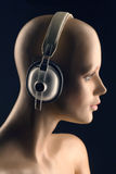 Stereo headphones. A dummy head with stereo headphones stock photo