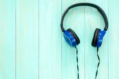 Stereo headphones on blue wooden background. With copy-space stock photo