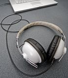 Headphones stereo wired on a tabletop. Stereo headphones on a gray table stock photos