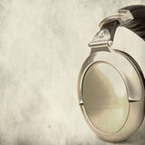 Stereo headphones over grunge background Royalty Free Stock Images