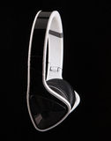 Stereo Headphones. Trendy black and white Headphones on a black background Royalty Free Stock Photos