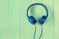 Stereo headphones on wooden background Stock Image