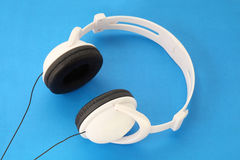 Stereo Headset with black stars and wire. White Stereo Headset with black stars and wire on blue background royalty free illustration