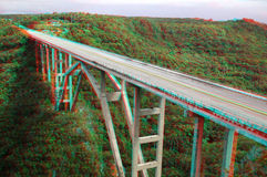 Stereo photo of bridge. 3D stereo anaglyph  bridge over a green valley in Cuba (need red-cyan glasses Royalty Free Stock Image
