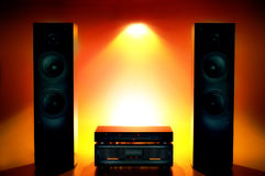 Stereo Sound System. Still life of a stereo sound system; cd player in the center; everything backlit in fiery colors royalty free stock images
