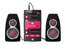 Stereo speaker set plugged into phone Stock Image