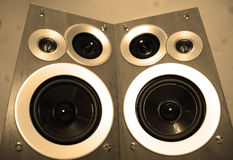 Stereo speakers. Black hi-fi stereo speakers in wooden boxes in sepia color Stock Images