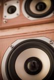 Stereo speakers. A close-up of stacked hi-fi stereo speakers.  Focus is on the woofer Stock Photography