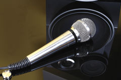 Stereo with speakers and microphone. Column with three speakers and a microphone on a black background Stock Photography