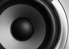 Stereo woofer macro. Closeup of a home theater stereo speaker royalty free stock photography