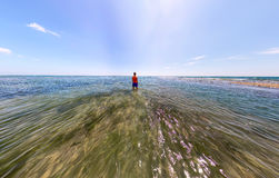 Stereographic wide-angle panorama a man stands in the sea Stock Image