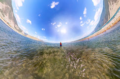 Stereographic wide-angle panorama a man stands in the sea Royalty Free Stock Image