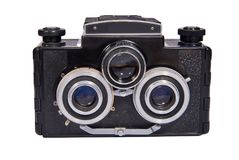 A stereoscopic film camera analog camera. That was made in the middle of the twentieth century. Isolated on a white background Stock Photography