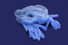 Sterile aseptic surgical glove blue background cap hat top view still life stock photo