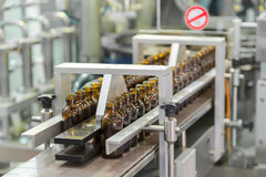 Sterile bottles on the production line conveyor of the pharmaceu Stock Photo