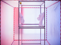 Sterile chamber in containment tent. Sterile chamber marked as bio hazardous in a containment tent with a pink and blue background stock photography