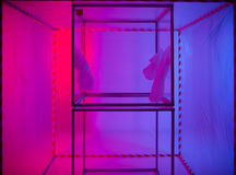 Sterile chamber in containment tent. Sterile chamber in a containment tent with a purple and blue background royalty free stock photo