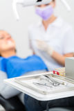 Sterile tools for dentist in practice. Sterile tools or medical instruments for a dentist, mirrors, tweezers, and syringe for local anesthetic in a dental stock photography