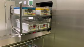sterilizer opens and releases the instruments stock video