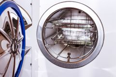 Sterilizing medical instruments in autoclave. Equipment for sterile cleaning of working medical instruments. Autoclave stock images