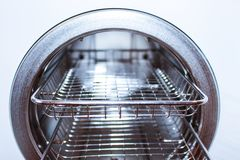 Sterilizing medical instruments in autoclave. Equipment for sterile cleaning of working medical instruments. Autoclave stock photo