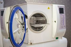 Sterilizing medical instruments in autoclave. Equipment for sterile cleaning of working medical instruments royalty free stock photos