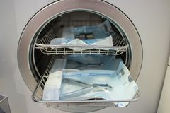 Sterilizing medical instruments in autoclave. Equipment for sterile cleaning of working medical instruments stock image