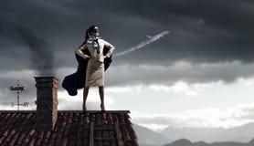 Sterk en krachtig als super held Gemengde media Stock Foto's