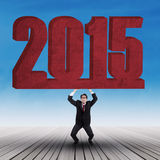 Sterk zakenman het opheffen nummer 2015 Royalty-vrije Stock Foto