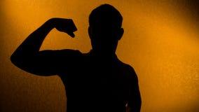 Sterkte en gezondheid - silhouet van de mens Stock Foto's