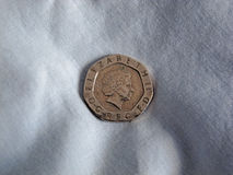Sterling 20p coin on linen Stock Image