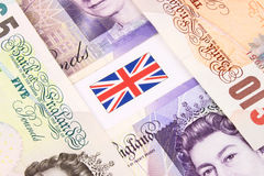 Sterling. A closeup of Sterling currency bank notes and Union Jack flag Stock Photography