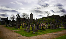 Sterling Churchyard. Graveyard in Sterling Scotland containing a church and old graves, With a granite hill in the background Royalty Free Stock Photos