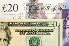 Sterling et billets de banque du dollar US 20 Photographie stock