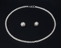 Sterling silver necklace and earrings stock photo