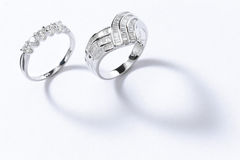 Sterling silver rings. Two sterling silver rings on plain background Royalty Free Stock Photos