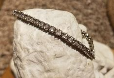 Sterling silver bracelet jewelry. Sterling silver rope bracelet fine jewelry shopping jeweler precious metal 925 royalty free stock image
