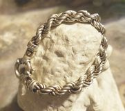 Sterling silver bracelet jewelry. Sterling silver rope bracelet fine jewelry shopping jeweler precious metal 925 stock image