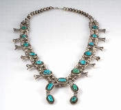 Sterling Silver and Turquoise Squash Blossom Necklace. Stock Image