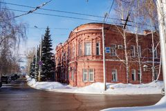 Beautiful orange brick building. City in the winter. stock photography