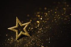 Stern-abstrakte Dekorations-Lichter, Goldscheine, unscharfer Glanz Stockbilder