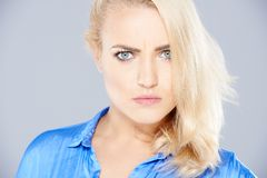 Stern angry blond woman Stock Image