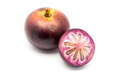 Stern Apple, Chrysophyllum Cainito, (goldener Laubbaum), thailändische Nordfrucht, lokalisiert Lizenzfreie Stockfotos