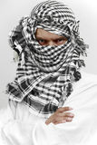 Stern arab muslim in shemagh kaffiyeh. Arab muslin in white cloth and kaffiyeh shemagh head gear with stern threatening look Stock Images