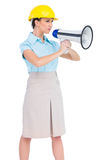 Stern attractive architect holding megaphone. Stern attractive architect on white background holding megaphone Stock Photography