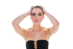 Stern attractive blonde model holding her head Royalty Free Stock Images