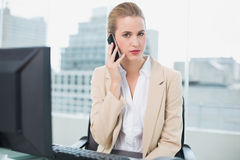 Stern attractive businesswoman on the phone Royalty Free Stock Image