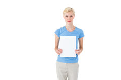 Stern blonde woman holding sheet of paper Royalty Free Stock Image