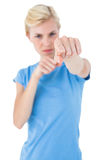 Stern blonde woman pointing with her finger Royalty Free Stock Photo