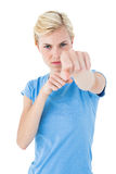 Stern blonde woman pointing with her finger Royalty Free Stock Photos